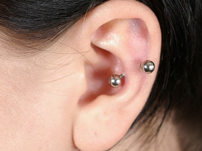 Cartilage piercing with silver studs