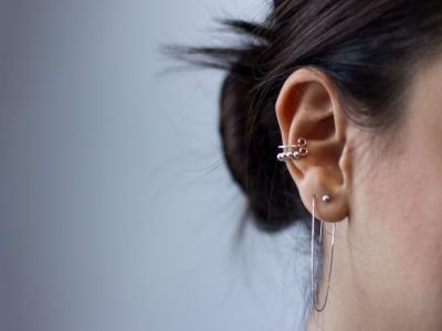 Woman with ear piercings
