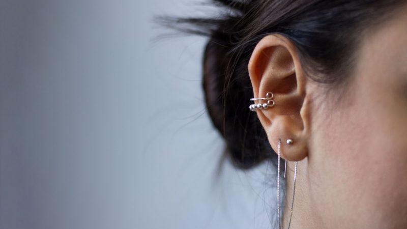 Woman with ear piercings