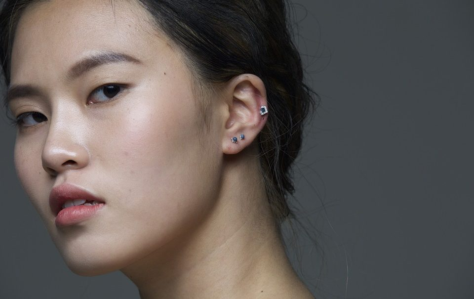 Woman with helix piercing