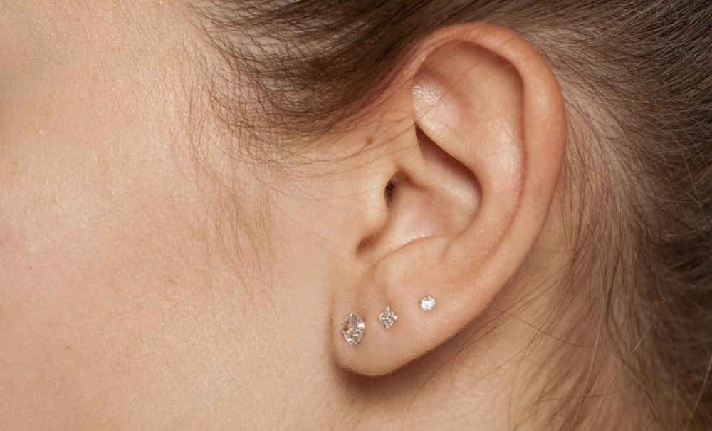 A girl with three ear piercings