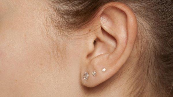 A girl with three ear piercings