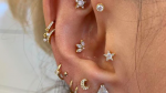 Close-up of a girl's ear piercings