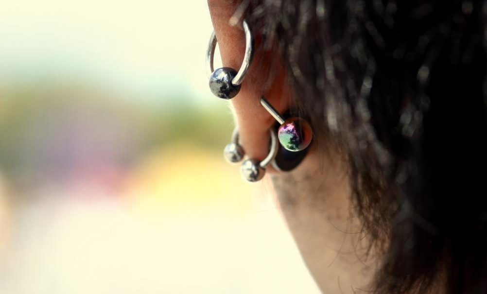 Girl with different ear piercings