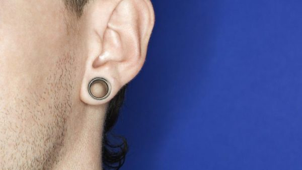 Man with a stretched lobe piercing