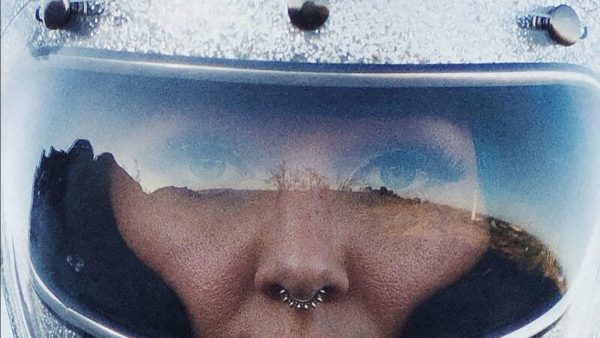 Woman with a nose piercing wearing a helmet